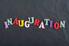 Iinauguration . English word on black board background composed from colorful abc alphabet block wooden letters, copy Royalty Free Stock Photography