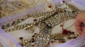Iindian show jewelry box. Iindian hand show jewelry in box on the wedding between european stock video footage