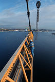 Iinstallers steeplejacks work on installing jib construction tow Royalty Free Stock Photo