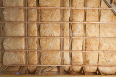 Iinsulation of attic with fiberglass cold barrier and insulation material. Iinsulation of attic with fiberglass cold barrier and insulation material royalty free stock images