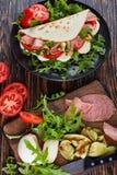 Iitalian kanapka - piadina na talerzu zdjęcie royalty free