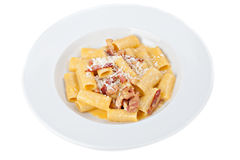 Iitalian rigatoni plate with prosciutto, parmesan cheese Royalty Free Stock Photos