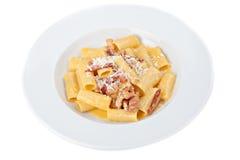 Iitalian rigatoni plate with prosciutto, parmesan cheese Royalty Free Stock Photos