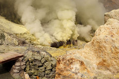 Ijen volcano crater sulfur mining royalty free stock photo
