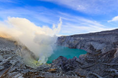 Ijen Volcano Crater with sulphuric acid smoke Stock Images
