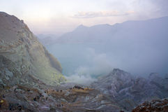 Ijen volcano in East Java spewing out sulphur smoke. Ijen volcano in East Java contains the world's largest acidic volcanic crater lake, called Kawah Ijen Stock Images