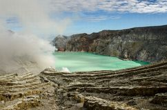 Ijen volcano. Kavah Ijen - turquoise colored acid crater lake stock images