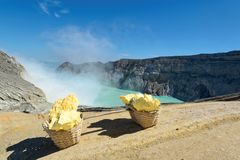 Ijen Volcano Sulphur Stones. The Ijen volcano complex is a group of composite volcanoes in the Banyuwangi Regency of East Java, Indonesia. It has a one-kilometre Stock Photo