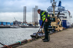 Ijmuiden, Netherlands - August 16 2015 : Police man checking the borders of the harbour Stock Image