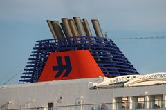 IJmuiden, the Netherlands -July 27th 2018: MS Europa 2, operated by Hapag-Lloyd Cruises. Leaving IJmuiden sea lock, detail of funnel with company logo royalty free stock photography