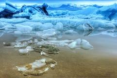 Ijsbergen in zonsondergang Stock Afbeeldingen