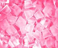 Ijsblokjes in roze licht. Stock Foto