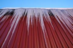 Ijskegel op het dak Stock Foto