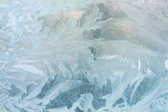 Ijzig bevroren patroon op glas stock foto's