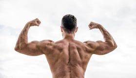 Ik ben de beste Macho met naakte rug aantoon zijn sterkte Spier achterdiemens op wit wordt ge?soleerd sportsman royalty-vrije stock foto