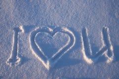Ik houd van u geschreven op een sneeuw Stock Foto