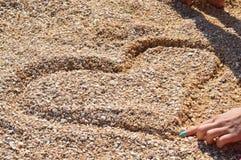 Ik houd van u (Hart in strand) Royalty-vrije Stock Foto's