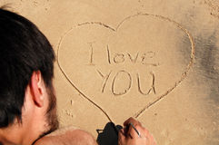 Ik houd van u, in het zand royalty-vrije stock foto's