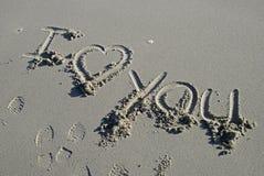 Ik houd van u inschrijving in zand Stock Afbeelding
