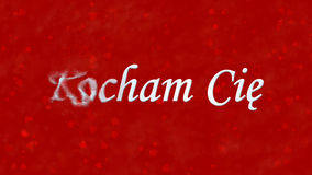 Ik houd van u tekst in de Poolse Kocham-draaien van Cie aan stof van linkerzijde op rode achtergrond Royalty-vrije Stock Foto