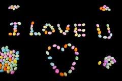 Ik houd van u- Tekst met Suikergoed Stock Afbeeldingen