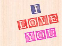 Ik houd van u, woorden die op houten worden gestempeld stock afbeelding
