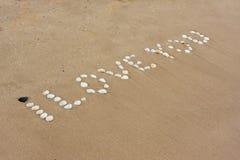 Ik houd van u in zand stock afbeeldingen