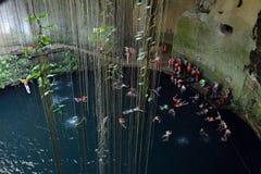 Ik-kil cenote in Yucatan peninsula, Mexico. Many swimmeres in Ik-kil cenote in Yucatan peninsula, Mexico. 09.01.2016 Stock Photos
