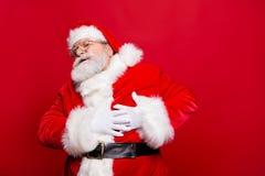 Ik moet terugtrekken me! Vermoeid ongelukkig zenuwachtig modieus oud Sinterklaas royalty-vrije stock foto's