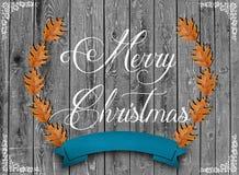 Ik wens u Vrolijke Kerstmis schreef en bruine bladeren stock foto