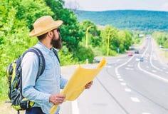 Ik word verloren op mijn manier Toeristen backpacker kaart het verloren richting reizen Rond de Wereld Vind het grote blad van de stock afbeeldingen