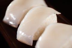 Ika Nigiri Sushi. Squid Hand formed Nigiri Sushi Stock Photo