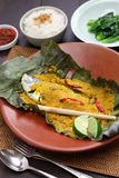 Ikan pepes, indonesian cuisine. Steamed fish wrapped in banana leaves Stock Image