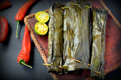 Ikan Pepes. Indonesian cuisine, steamed and grill fish wrapped in banana leaves Stock Images