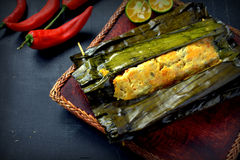 Ikan Pepes. Indonesian cuisine, steamed and grill fish wrapped in banana leaves Royalty Free Stock Photography