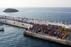 Ikaria, Evdilos pier - people wait for a ferry boat on the way Royalty Free Stock Photos