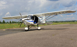 Ikarus C42 Ultralight Airplane. FORSSA, FINLAND � JULY 28, 2013: An ultralight Icarus C42 plane having landed on Forssa Airfield on July 28, 2013. In Europe Royalty Free Stock Photo