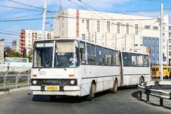 Ikarus 280. Chelyabinsk, Russia - September 18, 2009: White articulated bus Ikarus 280 in the city street royalty free stock photography