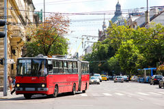 Ikarus Ganz 280.94. BUDAPEST, HUNGARY - JULY 23, 2014: Red articulated trolleybus Ikarus Ganz 280.94 in the city street royalty free stock images