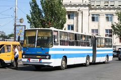 Ikarus 280. Volgograd, Russia - July 16, 2009: White and blue articulated bus Ikarus 280 in the city street stock photo