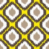 Ikat几何无缝的样式 黄色和棕色收藏 库存照片