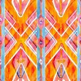 Ikat在水彩样式的几何红色和橙色地道样式 无缝的水彩 免版税库存图片