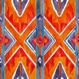 Ikat在水彩样式的几何红色和橙色地道样式 无缝的水彩 图库摄影