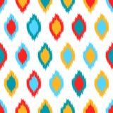 红色蓝色黄色和白色五颜六色的ikat亚洲传统织品无缝的样式,传染媒介 图库摄影