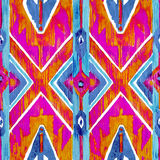 Ikat geometric red and orange authentic pattern in watercolour style. Watercolor seamless  . Stock Images