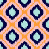 Ikat geometric seamless pattern. Orange and blue collection. Stock Photography