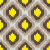 Ikat geometric seamless pattern. Yellow and brown collection. Royalty Free Stock Images
