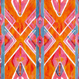 Ikat geometryczna czerwień i pomarańczowy autentyczny wzór w watercolour projektujemy Akwarela bezszwowa Zdjęcie Stock