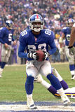 Ike Hilliard scores a touchdown. Wide Receiver Ike Hillard of the New York Giants scores a touchdown from a pass from New York Giants Quarterback Kerry Collins Royalty Free Stock Image