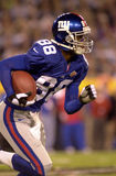 Ike Hilliard, Super Bowl XXXV. Wide Receiver Ike Hilliard of the New York Giants in action during Super Bowl XXXV. (Image taken from color slide Stock Images
